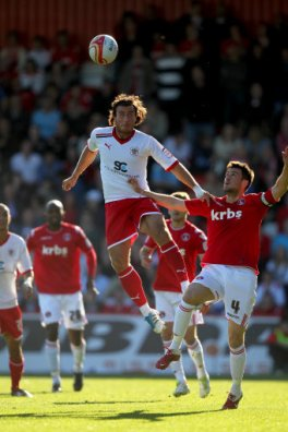 Stevenage's Lawrie Wilson and Charlton's Johnnie Jackson compete for the ball during the npower Football League One match at the Lamex Stadium, Stevenage.
