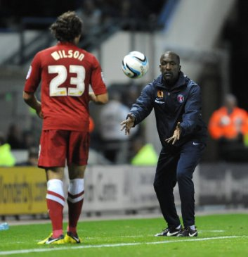 Charlton Athletic's Manager Chris Powell passes the ball to Lawrie Wilson during the game against Derby County.
