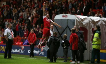 Charlton Athletic's Lawrie Wilson celebrates at the end of the match by running out of the tunnel and jumping in the air