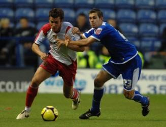 Leicester City's Joe Mattock (r) and Stevenage Borough's Lawrie Wilson battle for the ball