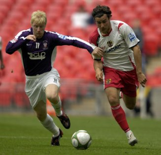 York City's Simon Russell and Stevenage Borough's Lawrie Wilson challenge for the ball during the FA Trophy Final at Wembley Stadium, London.